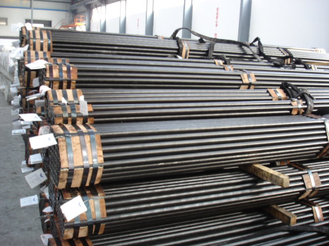 China steel, iron ore pare gains; hopes of demand pickup support